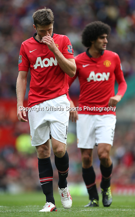 14th September 2013 - Barclays Premier League - Manchester United v Crystal Palace - Michael Carrick of Man Utd (L) and Marouane Fellaini of Man Utd - Photo: Simon Stacpoole / Offside.