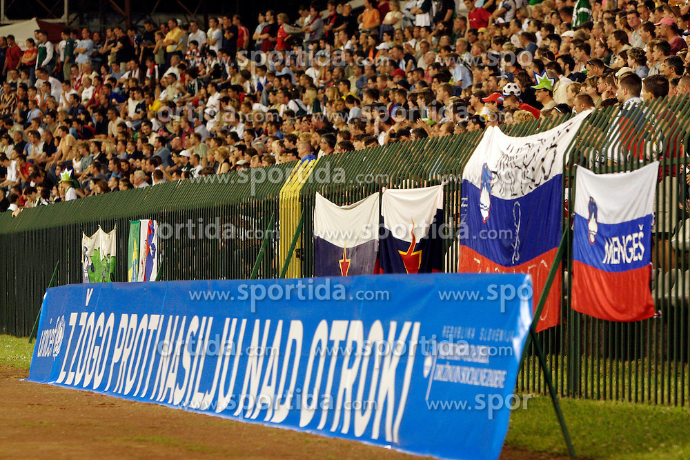 "Spectators at the last game of Slovenian ""golden team"" at Bezigrad stadion for football made by Joze Plecnik in year 1935, before rebuilded in 2008. The match was held on June 18, 2005. In front Unicef logo ""With a ball against violence at children"". (Photo by Vid Ponikvar / Sportal Images)."