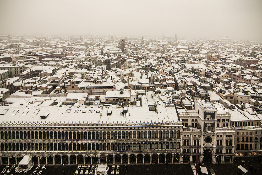VENICE, ITALY - 28th FEBRUARY/01st MARCH 2018<br /> Snow covered roofs in Venice, Italy. A blast of freezing weather called the &ldquo;Beast from the East&rdquo; has gripped most of Europe in the middle of winter of 2018, and in Venice A snowfall has covered the city with white, making it fascinating and poetic for citizen and tourists.   &copy; Simone Padovani / Awakening