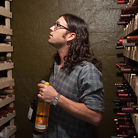 "Featured in Wine Spectator. Nathan Followill in his 500 bottle wine cellar; a ""cave"", carved into a limestone hill."