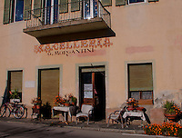 Ticino, Southern Switzerland. Macellaria, frontage of an old stone building decorated with flowers.  Valle Onsernone.