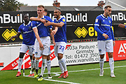 Oldham Athletic celebrate goal scored by Oldham Athletic forward Sam Surridge (9) to go 0-2 during the EFL Sky Bet League 2 match between Grimsby Town FC and Oldham Athletic at Blundell Park, Grimsby, United Kingdom on 15 September 2018.