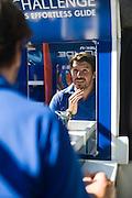 Riaan Manser, spokesman for Gillette, shaves at 2012 Cape Argus