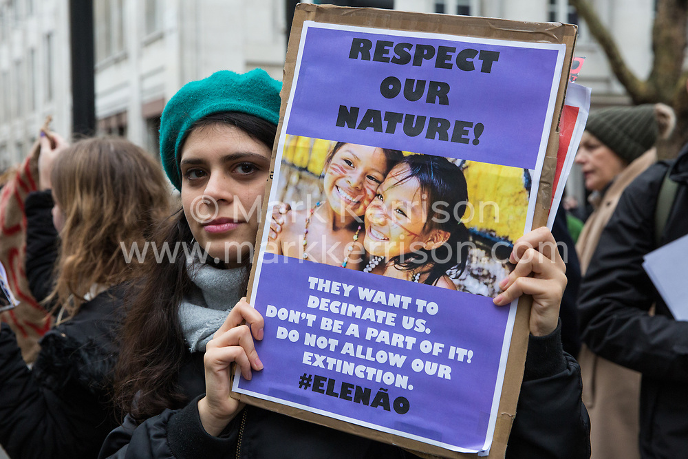 London, UK. 12th January, 2019. A supporter of Brazilian Women Against Fascism and Ele Não Students London demonstrates outside the Brazilian embassy in solidarity with women, students, environmental campaigners, black communities, LGBTQIA+ communities, indigenous peoples, peasants and workers protesting in Brazil following the inauguration of President Jair Bolsonaro.