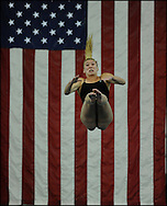 March 1, 2014 - Atlanta, GA.:  Florida International  University's diver Sabrina Beaupre, Longueuil CAN, performs as a giant American flag hangs behind her  during the 2014 Conference USA Women's Swimming and Diving Championship and Men's Invitational on Saturday , March 1, 2014 at Georgia Tech.  She won first place in the Women Platform Diving.  Johnny Crawford/ Special