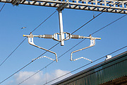 Detail of rail overhead electrification lines, Cardiff, South Wales, UK