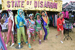 Latitude Festival, Henham Park, Suffolk, UK July 2018. Workers at State of Disarray, one of the mainy funky clothes stalls