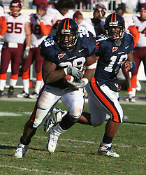 Virginia fullback Jason Snelling (38) carries the ball against VT.  The Virginia Tech Hokies defeated The Virginia Cavaliers 52-14 on November 19, 2005 at Scott Stadium in Charlottesville, VA.