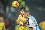 Joel Lynch (Huddersfield Town) gets his head to the ball to clear the cross during the Sky Bet Championship match between Huddersfield Town and Rotherham United at the John Smiths Stadium, Huddersfield, England on 15 December 2015. Photo by Mark P Doherty.