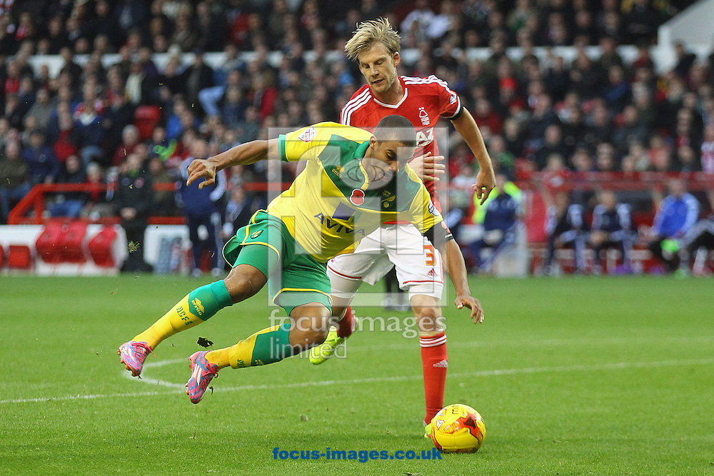 Lewis Grabban of Norwich and Daniel Harding of Nottingham Forest in action during the Sky Bet Championship match at the City Ground, Nottingham<br /> Picture by Paul Chesterton/Focus Images Ltd +44 7904 640267<br /> 08/11/2014