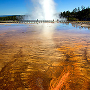 Steam shoots high into the air from Excelsior Geyser at Midway Geyser Basin, Yellowstone National Park, Wyoming.