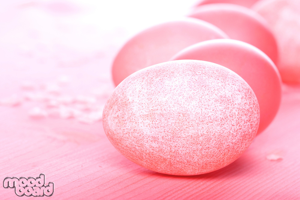 Easter eggs on pink background