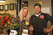 Alice Doyle, Log House Plants, and Karl Holl, LetUmEat, at the Indigo Tomato table where Karl created a stuffed tomato tasting.