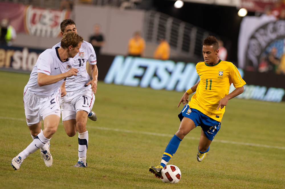 USMNT's Steve Cherundolo and Alejandro Bedoya attempt to stop Neymar of Brazil's drive during an International friendly between the USMNT vs Brazil at Giants Stadium.