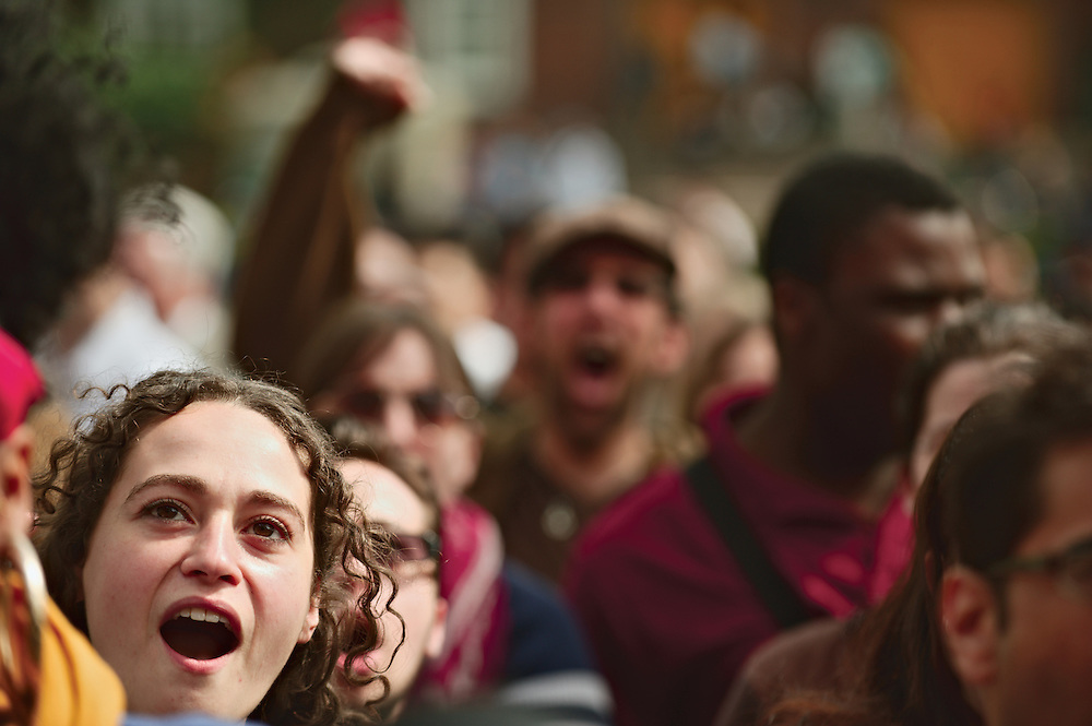 Faces in crowd during rally against tuition increase at Brooklyn College, Brooklyn, New York