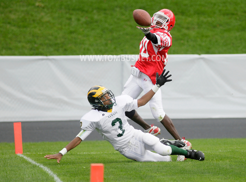 Thiells, New York - A North Rockland receiver reaches over a Ramapo defender for the ball in a high school football game on Sept. 26, 2009.