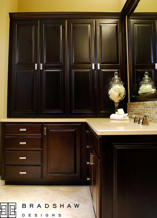 SHAVANO PARK AFTER - AND RICH ESPRESSO CABINETS PROVIDE PLENTY OF STORAGE FOR HIM