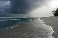 Afternoon rain storm over the D'Arros Island coastline, D'Arros Island and St Joseph Atoll, Amirantees, Seychelles,