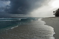 Afternoon rain storm over the D'Arros Island coastline, D'Arros Island and St Joseph Atoll, Amirantees, Seychelles,