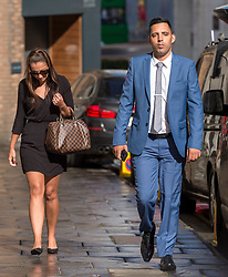 © Licensed to London News Pictures. 08/08/2018. Bristol, UK. RYAN ALI (R) arrives at Bristol Crown court today for the third day of his trial on charges of affray that relate to a fight outside a Bristol nightclub on September 25 2017. England cricketer Ben Stokes and two other men, Ryan Ali, 28, and Ryan Hale, 27, all deny the charge. Stokes, Ali and Hale are jointly charged with affray in the Clifton Triangle area of Bristol on September 25 last year, several hours after England had played a one-day international against the West Indies in the city. A 27-year-old man allegedly suffered a fractured eye socket in the incident. Photo credit: Simon Chapman/LNP