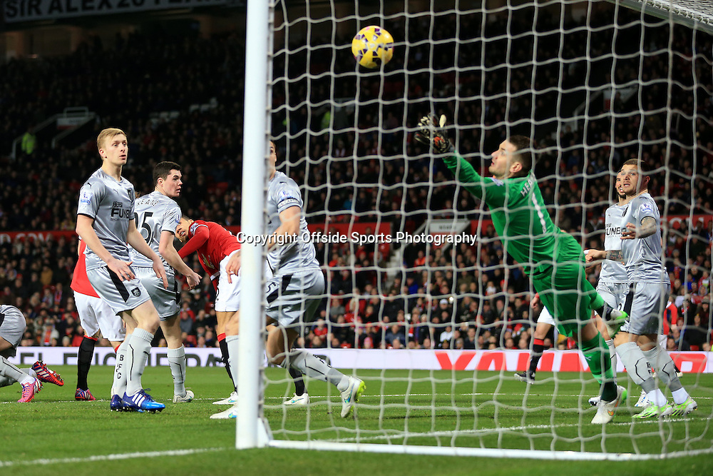 11th February 2015 - Barclays Premier League - Manchester United v Burnley - Chris Smalling of Man Utd scores their 1st goal - Photo: Simon Stacpoole / Offside.