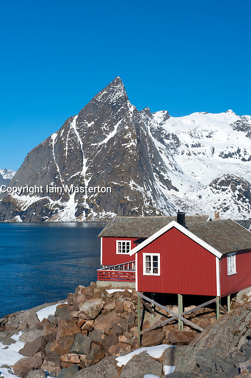 Traditional red wooden Rorbu fishermen`s huts in village of Hamnoy on Moskenesoya Island in Lofoten Islands in Norway