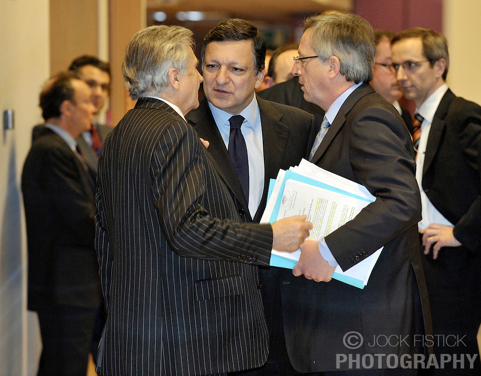 Jean-Claude Juncker, Luxembourg's prime minister and president of Euro Group, right, speaks with Jean-Claude Trichet, president of the European Central Bank, left, and Jose Manuel, Barroso, president of the European Commission, center, before the start of the monthly Euro Group meeting in Brussels, Belgium, Monday, Feb. 9, 2009. (Photo © Jock Fistick)