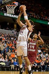Virginia forward/center Ryan Pettinella (34) shoots past Boston College center Tyrelle Blair (44).  The Virginia Cavaliers men's basketball team defeated the Boston College Golden Eagles 84-66 at the John Paul Jones Arena in Charlottesville, VA on January 19, 2008.