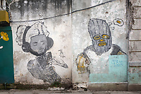 Two large scale guys on white background street art in Havana.