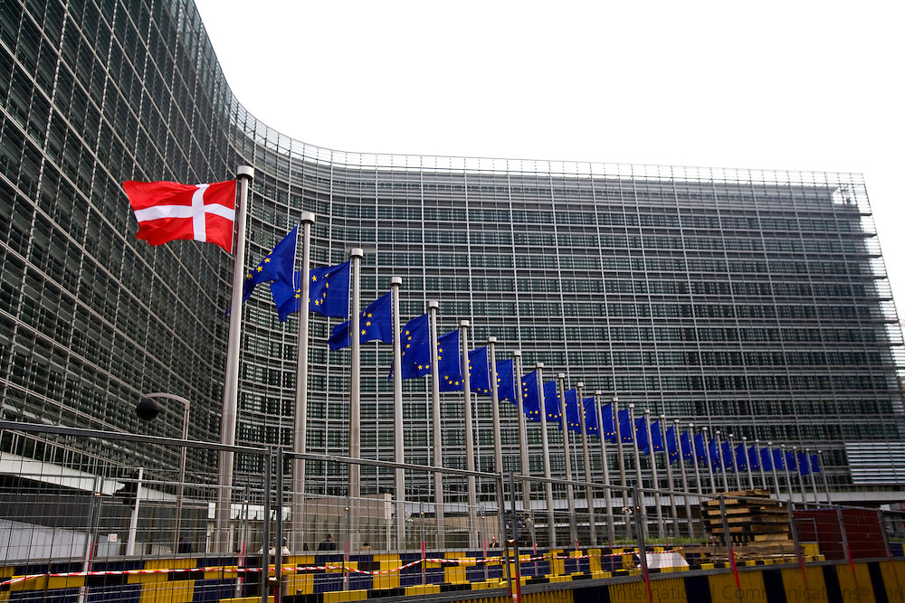 BRUSSELS - BELGIUM - 13 MAY 2009 -- The Danish flag next to the EU flags in front of the EC HQ Berlaymont.  Photo: Erik Luntang