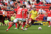 Burnley midfielder, Dean Marney (08) taking on Charlton Athletic midfielder, Alou Diarra (12) during the Sky Bet Championship match between Charlton Athletic and Burnley at The Valley, London, England on 7 May 2016. Photo by Matthew Redman.