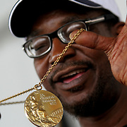 Boxer and 1972 Olympic Gold Medalist Sugar Ray Seales holds up his Gold medal during the 23rd Annual International Boxing Hall of Fame Induction ceremony at the International Boxing Hall of Fame on Sunday, June 10, 2012 in Canastota, NY. (AP Photo/Alex Menendez)