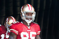18 September 2011:  Tight end (85) Vernon Davis of the San Francisco 49ers stands in the tunnel before his name is called during player introductions before the Cowboys 27-24 overtime victory against the 49ers in an NFL football game at Candlestick Park in San Francisco, CA