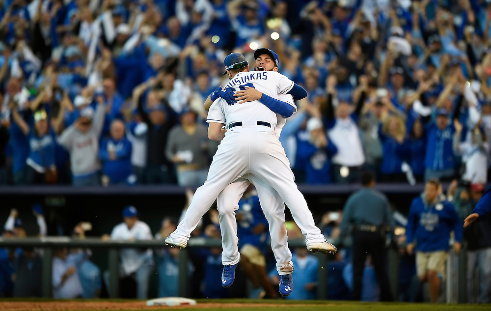 Kansas City Royals first baseman Eric Hosmer (35) hugged Kansas City Royals third baseman Mike Moustakas (8) after the final out to clinch the AL pennant during Wednesday's ALCS Game 4 against the Baltimore Orioles on October 15, 2014 at Kauffman Stadium in Kansas City, Mo.