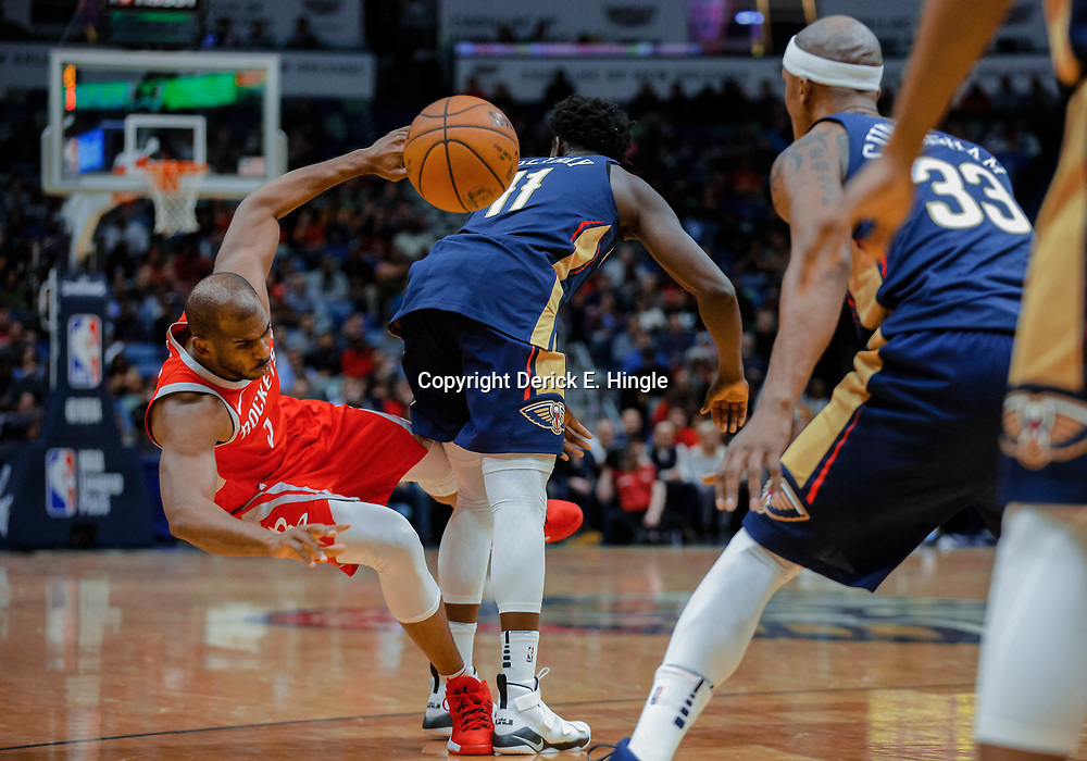 Jan 26, 2018; New Orleans, LA, USA; Houston Rockets guard Chris Paul (3) collides with New Orleans Pelicans guard Jrue Holiday (11) during the first quarter at the Smoothie King Center. Mandatory Credit: Derick E. Hingle-USA TODAY Sports