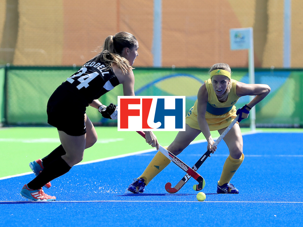RIO DE JANEIRO, BRAZIL - AUGUST 15:  Rose Keddell #24 of New Zealand controls the ball against Emily Smith #26 of Australia at Olympic Hockey Centre on August 15, 2016 in Rio de Janeiro, Brazil.  (Photo by Sam Greenwood/Getty Images)