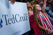 A young supporter waits for U.S. Senator and GOP presidential candidate Ted Cruz to arrive for the kick off of his campaign bus tour at the Liberty Tap Room restaurant August 7, 2015 in Mt Pleasant, South Carolina. Cruz began a seven-day bus tour called the Cruz Country Bus Tour of southern states following the event.