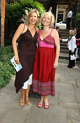 Left to right, TV presenters PENNY SMITH and MARIELLA FROSTRUP at the annual House of Lords v House of Commons tug of war match in aid of  of  Macmillan Cancer Relief on 21st June 2005.  A drinks reception was held in College Gardens followd by the tug of war on Victoria Tower Gardens, London.                                 <br />