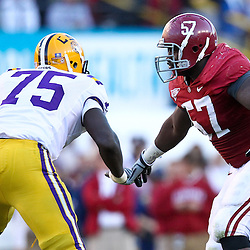 November 6, 2010; Baton Rouge, LA, USA; Alabama Crimson Tide defensive tackle Marcell Dareus (57) rushes against LSU Tigers offensive tackle Greg Shaw (75) during the second half at Tiger Stadium. LSU defeated Alabama 24-21.  Mandatory Credit: Derick E. Hingle