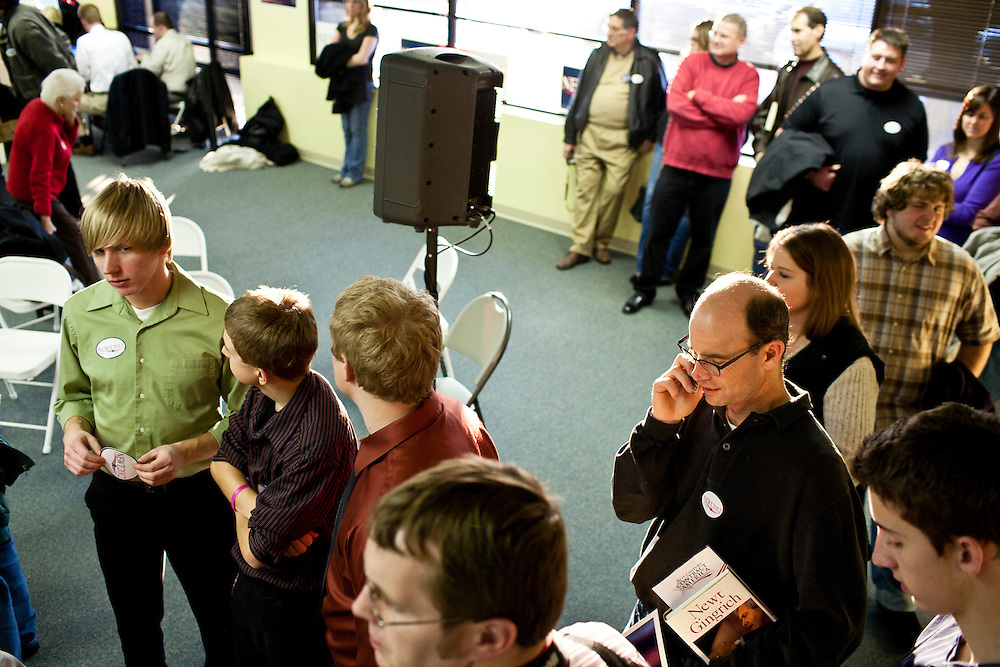 Audience members wait in line for pictures and autographs with Republican presidential candidate Newt Gingrich at the opening of a new campaign office on Saturday, December 10, 2011 in Urbandale, IA.