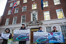 London, UK. 6 December, 2019. Activists from Sea Life Extinction Rebellion, joined by activists from Animal Rebellion, protest against super-trawlers outside the European Commission's offices in Westminster. Super-trawlers are responsible for much illegal fishing, using nets as large as three football pitches, catching endangered species such as hammerhead sharks and dolphins and processing, storing and freezing thousands of tons of fish during weeks of continuous fishing.