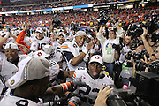 ATLANTA - DECEMBER 4:  Quarterback Cam Newton #2 of the Auburn Tigers (center) celebrates with his teammates after the 2010 SEC Championship game against South Carolina Gamecocks at Georgia Dome on December 4, 2010 in Atlanta, Georgia. (Photo by Mike Zarrilli/Getty Images)