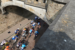 The peloton passes through the gateway to Ieper at Gent Wevelgem - Elite Women 2019, a 136.9 km road race from Ieper to Wevelgem, Belgium on March 31, 2019. Photo by Sean Robinson/velofocus.com