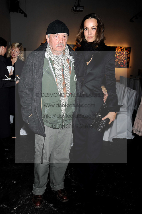 DAVID BAILEY and his wife CATHERINE at an exhibition entitled 'Cut Flowers' by Robin Derrick held at 70a Silverthorne Road, London SW8 on 8th October 2008.