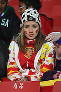 21 JUN 2010: A cold Spain fan. The Spain National Team defeated the Honduras National Team 2-0 at Ellis Park Stadium in Johannesburg, South Africa in a 2010 FIFA World Cup Group H match.
