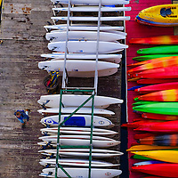 A deckhand walks past stacked up water craft at the end of his day at a boat rental shop along the Potomac River in Washington, DC, Thursday, May 19, 2016.