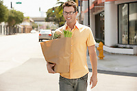 Man Carrying Groceries Home After Shopping