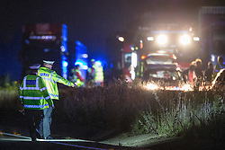 © Licensed to London News Pictures . 21/07/2014 . Nottinghamshire , UK . Police search the area for evidence . Police , fire crew and ambulances on the A1 road in Ranby yesterday morning (21st July 2014) following a fatal multi vehicle accident . Leroy and Sheila Carrington (aged 68 and 58) died at the scene when the Peugot 206 they were driving collided with a Vauxhall Astra . Roderick Franks (58) , who was a passenger in the Astra , died in hospital , following the crash . The road was closed in both directions whilst police investigated the scene .  Photo credit : Joel Goodman/LNP