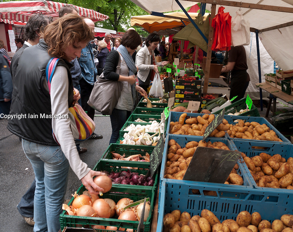 Vegetable stall in busy weekend market at Prenzlauer Berg in Berlin Germany