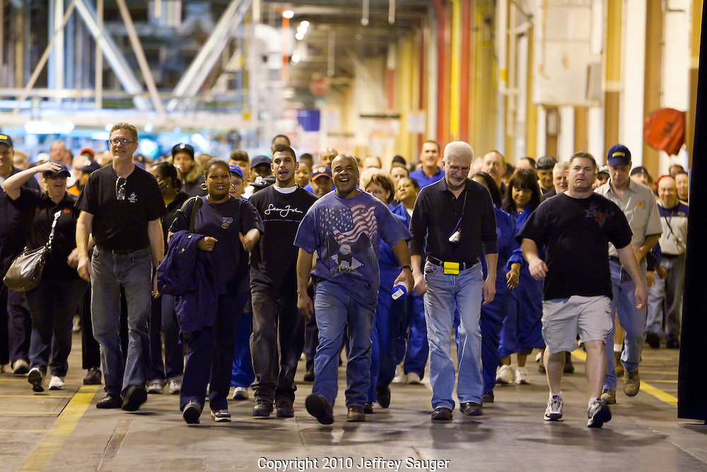 General Motors Detroit-Hamtramck plant workers walk along the assembly line to an event celebrating the production of the Chevrolet Volt electric vehicle with extended range capabilities Tuesday, November 30, 2010 in Detroit, Michigan. GM announced the Volt will soon be shipped to dealers in initial launch markets, and that GM will add 1,000 engineers and researchers in Michigan over the next two years, to expand its vehicle electrification expertise and the development of electric vehicles. (Photo by Jeffrey Sauger for Chevrolet) (11/30/2010)